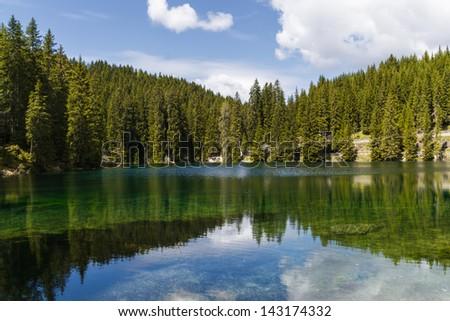 idyllic mountain lake Location: Lake Carezza (Karersee) South Tyrol, Dolomites, European Alps, Italy - stock photo