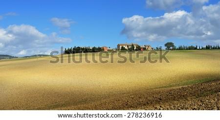 Idyllic rural Tuscan landscape with old farmhouse near Pienza, Italy, Europe - stock photo