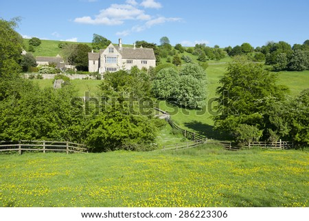 Idyllic rural view of gently rolling  farmland  in  the Cotswolds, England, UK.