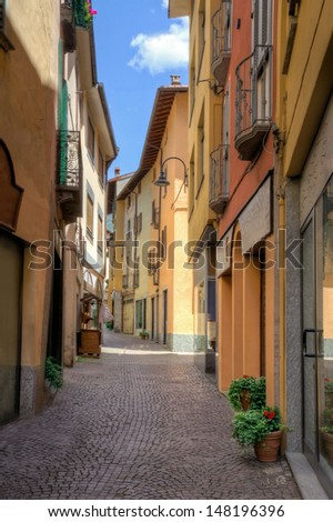 Idyllic small town street view in old town Porlezza in Lake Como district Italy - stock photo