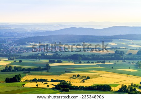Idyllic Spring countryside Landscape. Farmland, Villages, Hills and Meadows - stock photo