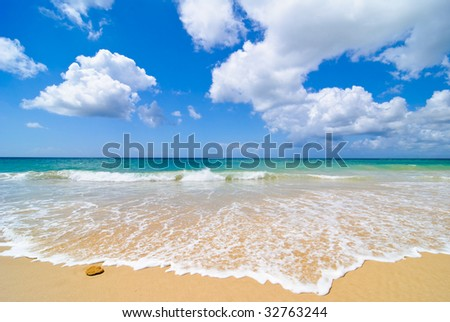 Idyllic summer beach in Portugal with beautiful sky