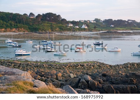 idyllic sundown with some boats at the Pink Granite Coast in Brittany, France