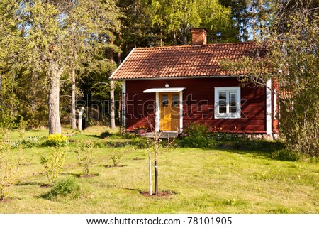 Idyllic Swedish house. typical old wooden, painted red and white. - stock photo