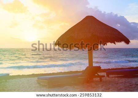 idyllic tropical beach of Carribean sea, Mexico at sunset - stock photo