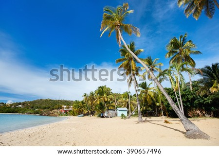 Idyllic tropical Carlisle bay beach with white sand, turquoise ocean water and blue sky at Antigua island in Caribbean - stock photo