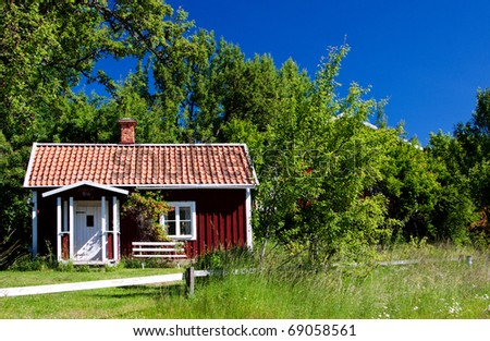 Idyllic, typical swedish cottage in summer time. - stock photo