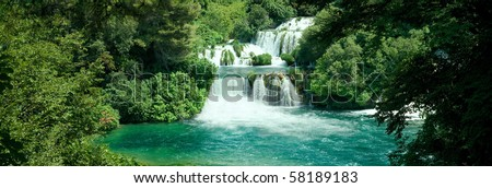 Idyllic Waterfall in Forest - stock photo