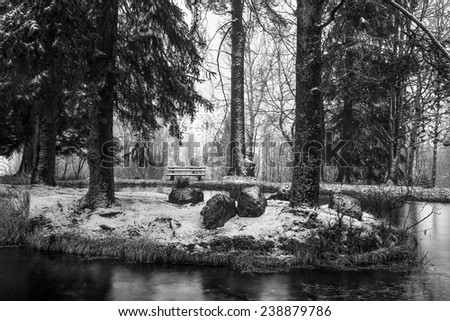 Idyllic Winter Park. Vintage Black and White. Romantic Loneliness. Heavy snowing - stock photo