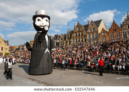 IEPER, BELGIUM - MAY 13, 2012: Big statue of Ieper cat takes park in the 43th edition of the Cat Parade in Ieper, Belgium on May 13, 2012 - stock photo