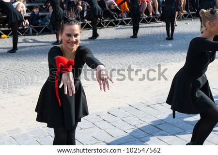 IEPER, BELGIUM - MAY 13, 2012: Smiling teenager girl with cat ears dances on the 43th edition of the Cat Parade in Ieper, Belgium on May 13, 2012 - stock photo