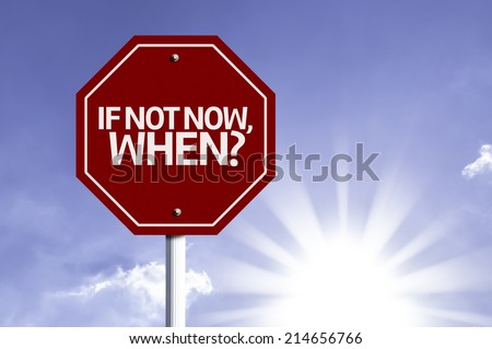If Not Now, When? red sign with sun background  - stock photo
