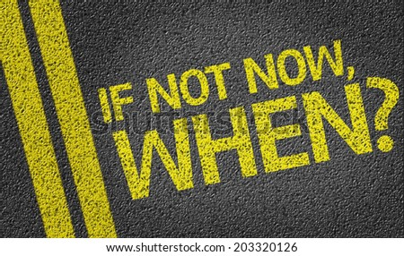 If not Now, When? written on the road - stock photo