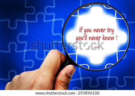 If you never try you'll never know word. Magnifier and puzzles. - stock photo