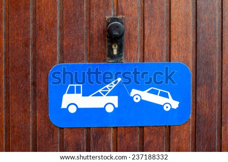 if you stand at the gate you will be towed - stock photo