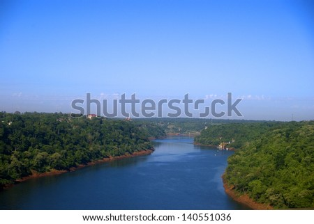 Iguacu River at the border of Brasil, Argentina and Paraguay - stock photo