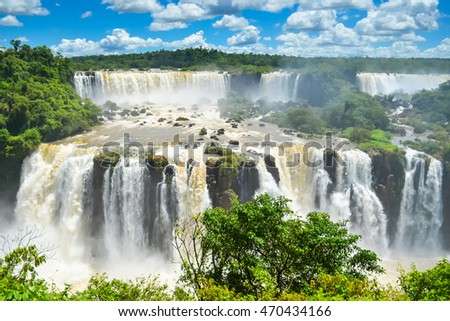 Iguassu falls wide and strong on the border of Brazil and Argentina with soft focus