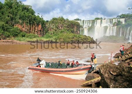 IGUAZU, ARGENTINA - MAY 4, 2008: Unidentified tourists at the Iguazu falls on the border of Argentina and Brazil - stock photo