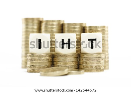 IHT (Inheritance Tax) on gold coins with a white background - stock photo