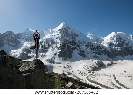 ilhouette of Outdoor Yoga, Young Woman in Tree Pose - stock photo