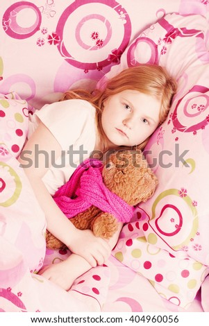 Ill girl with toy - stock photo