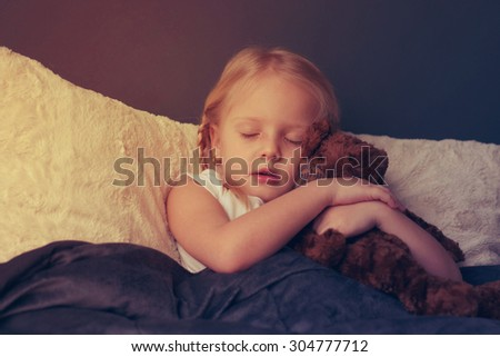 Ill girl with toy bear in the bed  - stock photo