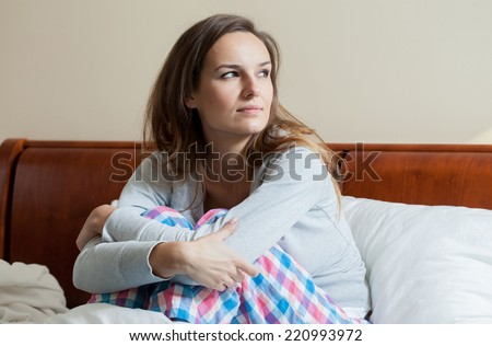 Ill woman in bed during morning, horizontal - stock photo