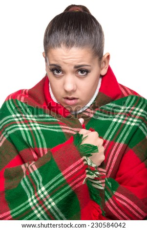Ill woman is covered with plaid blanket, isolated on the white background. - stock photo
