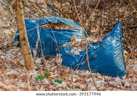Illegal discarded garbage bags with garden waste - stock photo