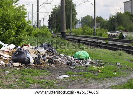 Illegal garbage dump near the railroad. Kiev, Ukraine