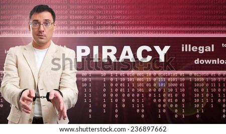 illegal piracy download concept. man in handcuffs - stock photo