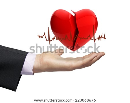 illness concept: a broken hearth over a businessman hand with electrocardiogram