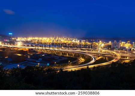 Illuminated and elevated expressway and cityscape at night - stock photo