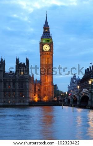 Illuminated Big Ben with evening sky - stock photo