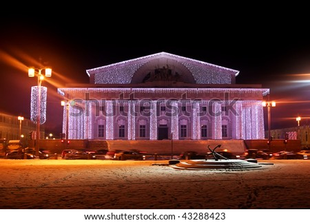 Illuminated building and anchor in New Year's Eve - stock photo