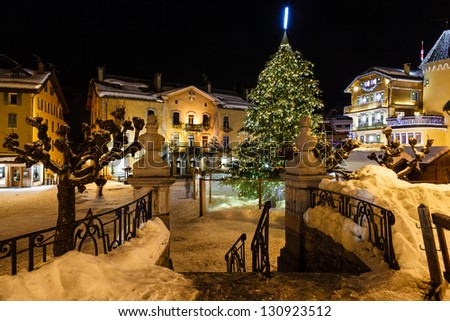 Illuminated Central Square of Megeve on Christmas Eve, French Alps, France - stock photo