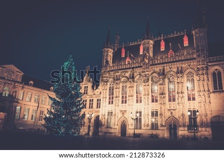 Illuminated Christmas tree on a Burg square in Bruges, Belgium - stock photo