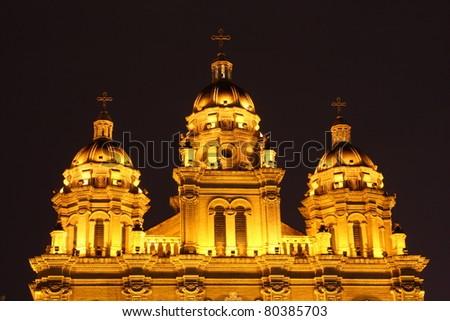 Illuminated Church steeple, by night - stock photo