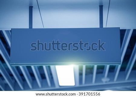 Illuminated Corporate Office Exit Sign Closeup. - stock photo