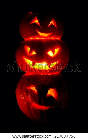 Illuminated cute halloweens pumpkin isolated on black background - stock photo