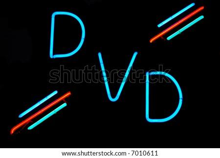 Illuminated DVD neon sign on black background - stock photo
