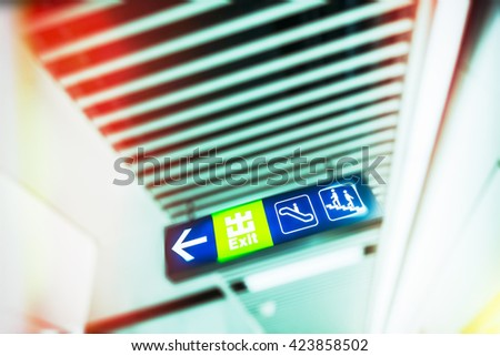 Illuminated Exit Sign in modern public space - stock photo