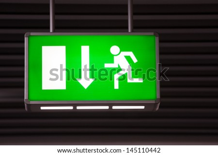 Lighting color and entity? Stock-photo-illuminated-green-exit-sign-attached-to-the-ceiling-in-a-public-transportation-facility-signage-145110442