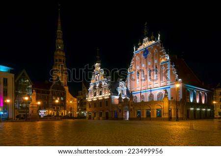 Illuminated house of the Blackheads at night in Riga, Latvia - stock photo