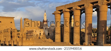Illuminated Luxor Temple at Sunset. The Peristyle Court of Amenhotep III and Hypostyle Hall of Egypt. - stock photo