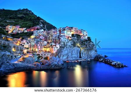 Illuminated Manarola Village at Dusk, Cinque Terre, Italy - stock photo