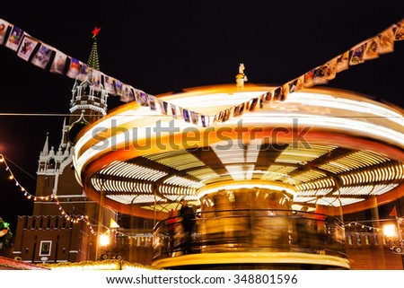 illuminated merry-go-round carousel on Red Square on Moscow Christmas Fair - stock photo