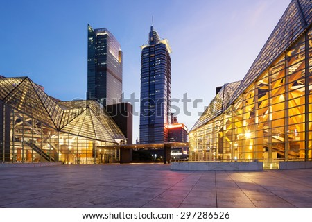 Illuminated modern building exterior and  empty street - stock photo