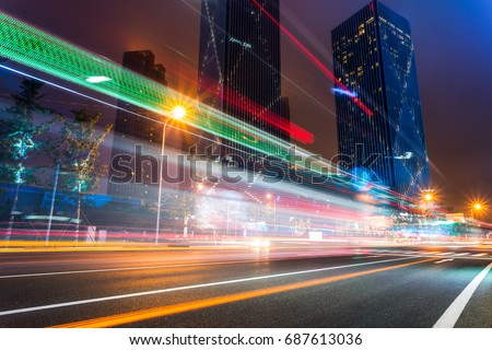 illuminated modern skyscrapers with traffic trails at night,tianjin city,china.