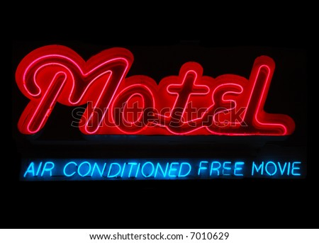 Illuminated motel neon sign with air conditioning and free movie - stock photo